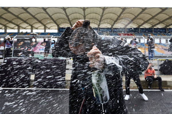 Lewis Hamilton, Mercedes-AMG Petronas F1, is sprayed with champagne after winning his 7th World Championship