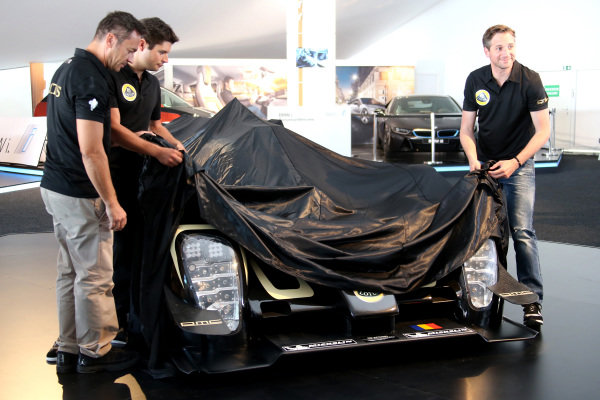 Official unveiling of the all new Lotus T129 LMP1 prototype car at the Innovation Centre. The Kodewa Racing Team are now hopeful of having the car ready for the fifth round of the WEC: the 6 Hours of Circuit of the Americas in Austin, Texas on 20 September 2014.Lotus LMP Team including drivers Christijan Albers (NED), right, Christophe Bouchut (FRA), left, and Pierre Kaffer (GER), centre.24 Heures du Mans, Le Mans, France, 12 June 2014.