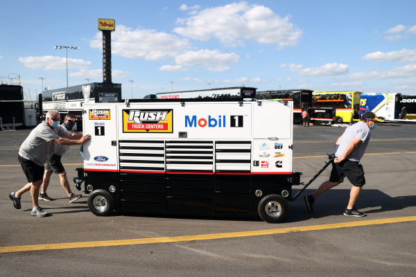 NASCAR Cup Series haulers are unloaded in the garage area  Copyright: Chris Graythen/Getty Images.