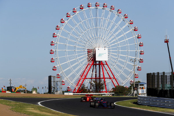 Daniil Kvyat, Toro Rosso STR14, leads Charles Leclerc, Ferrari SF90