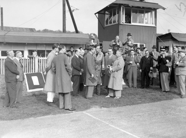 HRH Duke of Kent (programme in hand), President-in-chief of the BRDC, meets Adolf Huhnlein, head of the NSKK (with binoculars around neck).
