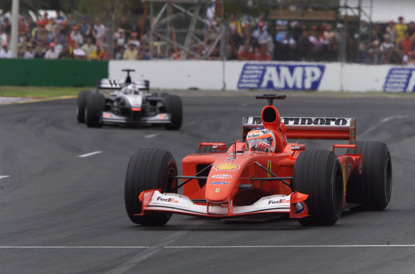 Australian Grand Prix.Albert Park, Melbourne, Australia. 2-4 March 2001.Rubens Barrichello (Ferrari F2001) followed by David Coulthard (McLaren MP4/16 Mercedes). They finished in 3rd and 2nd positions respectively.World Copyright - Steve Etherington/LAT Photographicref: 18MB Digital Image