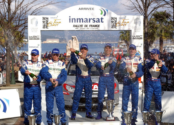 2002 World Rally ChampionshipInmarsat Corsica Rally, 8th-10th March 2002.The Peugeot drivers spray the champagne on the podium after creating an historic 1-2-3 victory.Photo: Ralph Hardwick/LAT