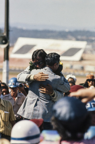 Emerson Fittipaldi is congratulated on his victory on the podium.