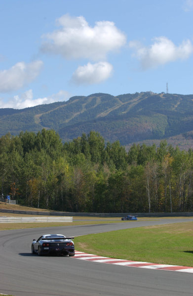 2002 Mont- Tremblant 6hr. Grand Am, Tremblant, CanadaSeptember 2002The Falcon Ferrari 360 GT entry with a view of the famous ski resort Mont-Tremblant looming behind and above.C:2002, Douglas Phillips, USALAT Photographic