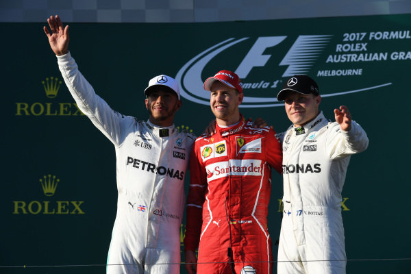 Lewis Hamilton (GBR) Mercedes AMG F1, Sebastian Vettel (GER) Ferrari and Valtteri Bottas (FIN) Mercedes AMG F1 celebrate on the podium at Formula One World Championship, Rd1, Australian Grand Prix, Race, Albert Park, Melbourne, Australia, Sunday 26 March 2017.