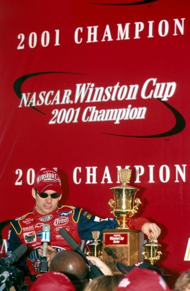 Fourth time NASCAR Winston Cup title winner Jeff Gordon (USA) shows off his trophy to the assembled media.