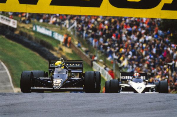 Ayrton Senna, Lotus 97T Renault, leads Marc Surer, Brabham BT54 BMW.