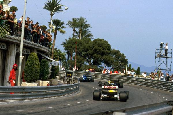 Monte Carlo, Monaco.4-7 May 1989.Riccardo Patrese (Williams FW12C Renault) follows Johnny Herbert (Benetton B188 Ford) and Rene Arnoux (Ligier JS33 Ford) around Massenet.Ref-89 MON 28.World Copyright - LAT Photographic
