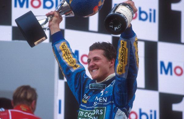 1994 European Grand Prix.Jerez, Spain.14-16 October 1994.Michael Schumacher (Benetton Ford) celebrates 1st position on the podium.Ref-94 EUR 04.World Copyright - LAT Photographic