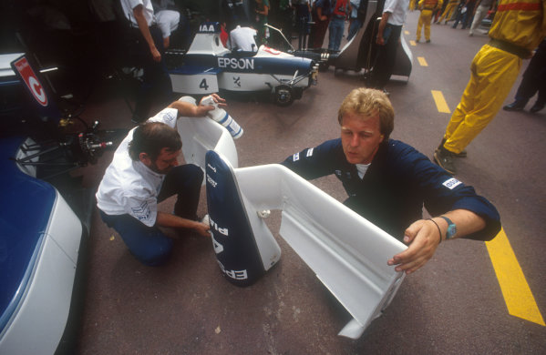 1990 Monaco Grand Prix.Monte Carlo, Monaco.25-27 May 1990.Mechanics clean the newly designed anhedral-dyhedral nose from Alesi's Tyrrell.Ref-90 MON 22.World Copyright - LAT Photographic