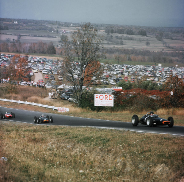 Watkins Glen, New York, USA.4-6 October 1963.Graham Hill leads Richie Ginther (both BRM P57) and John Surtees (Ferrari Dino 156). Hill and Ginther finished in 1st and 2nd positions respectively.Ref-3/1092.World Copyright - LAT Photographic