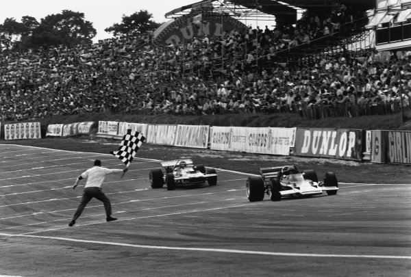 Brands Hatch, England. 16th - 18th July 1970.Jochen Rindt (Lotus 72C-Ford), 1st position, leads Ronnie Peterson (March 701-Ford), 9th position, across the finish line and takes the chequered flag, action.World Copyright: LAT Photographic.Ref:  L70 - 724 - 18A.