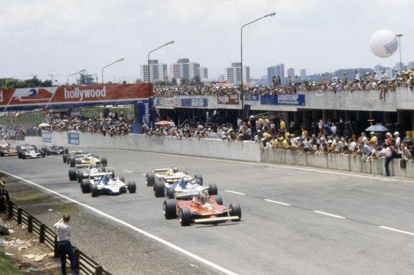 1980 Brazilian Grand Prix.Interlagos, Sao Paulo, Brazil. 25-27 January 1980.Gilles Villeneuve (Ferrari 312T5) leads Didier Pironi, Jacques Laffite (both Ligier JS11/15-Ford Cosworth), Jean-Pierre Jabouille (Renault RE20), Carlos Reutemann (Williams FW07B-Ford Cosworth), Rene Arnoux (Renault RE20) and Elio de Angelis (Lotus 81-Ford Cosworth) at the start.World Copyright: LAT PhotographicRef: 35mm transparency 80BRA04
