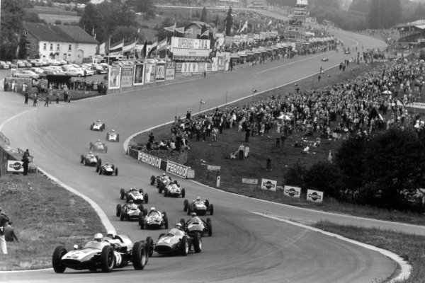 1960 Belgian Grand Prix Spa-Francorchamps, Belgium. 19 June 1960 Jack Brabham, Cooper T53-Climax, 1st position, leads Olivier Gendebien, Cooper T51-Climax, 3rd position, Phil Hill, Ferrari Dino 246, 4th position, Jo Bonnier, BRM P48, retired, Tony Brooks, Cooper T51-Climax, retired, Graham Hill, BRM P48, retired, Innes Ireland, Lotus 18-Climax, retired, Bruce McLaren, Cooper T53-Climax, 2nd position, Chris Bristow, Cooper T51-Climax, fatal accident, Dan Gurney, BRM P48, retired, Alan Stacey, Lotus 18-Climax, fatal accident, Wolfgang von Trips, Ferrari Dino 246, retired, Willy Mairesse, Ferrari Dino 246, retired, Chuck Daigh, Scarab, retired, and Lance Reventlow, Scarab, retired, at the start. Lucien Bianchi, Cooper T45-Climax, 6th position, and Jim Clark, Lotus 18-Climax, 5th position, make delayed starts from the grid in the background, action World Copyright: LAT PhotographicRef: Autosport b&w print. Published: Autosport, 24/6/1960 p864