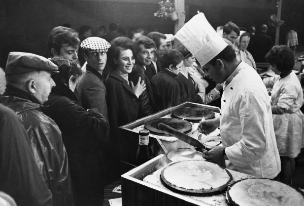 Le Mans, France. 18th - 19th June 1966. A chef makes Crepes for the spectators, atmosphere World Copyright: LAT Photographic Ref:  L66 - 380 - 12.