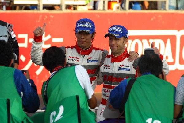 Twin Ring Motegi, Japan.15th - 16th October 2011GT500 2011 Driver's Champion Masataka Yanagida & Ronnie Quintarelli ( #46 S Road MOLA GT-R ) parcferme portrait.World Copyright: Yasushi Ishihara/LAT Photographicref: Digital Image 2011SGT_R8_014
