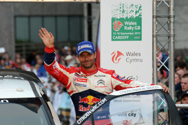 Sebastien Loeb (FRA), Citroen DS3 WRC, in 2nd place on the podium. FIA World Rally Championship, Rd10, Wales Rally GB, Day Three, Cardiff, Wales, 16 September 2012.