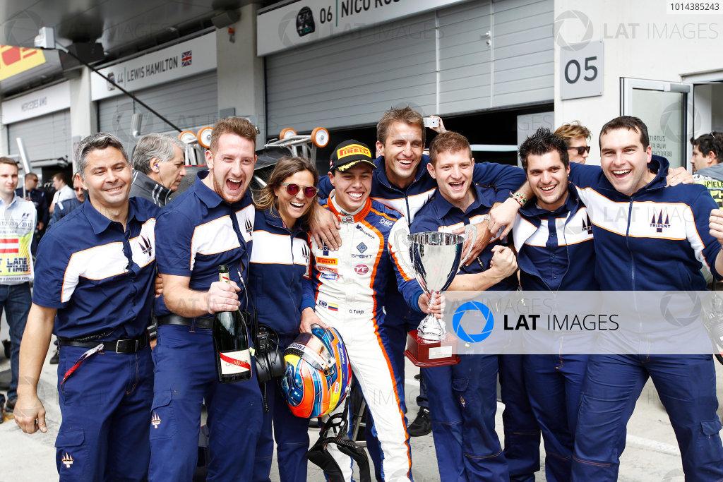 2015 GP3 Series Round 2.  Red Bull Ring, Spielberg, Austria.  Sunday 21 June 2015. Oscar Tunjo (COL, Trident) celebrates his win with his team. Photo: Sam Bloxham/GP3 Media Service  ref: Digital Image _G7C5970