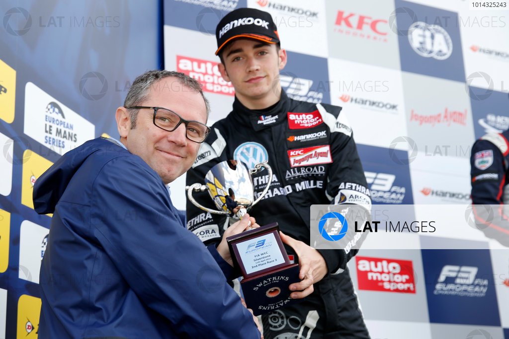 FIA F3 European Championship - Round 1, Race 2. Silverstone, Northamptonshire, UK 10th - 12th April 2015 Prize giving ceremony, 7 Charles Leclerc (MCO, Van Amersfoort Racing, Dallara F312 – Volkswagen) getting the trophy of Stefano Domenicali (President FIA Single-Seater Commission). Copyright Free FOR EDITORIAL USE ONLY. Mandatory Credit: FIA F3. ref: Digital Image FIAF3-1428762620