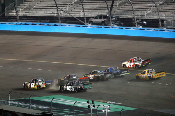 NASCAR Camping World Truck Series  Lucas Oil 150 Phoenix Raceway, Avondale, AZ USA Friday 10 November 2017 John Hunter Nemechek, ROMCO Equipment Co. / Fire Alarm Services, Inc. Chevrolet Silverado, Ryan Truex, Chiba Toyopet Toyota Tundra, 5-wide through the apron World Copyright: Michael L. Levitt LAT Images