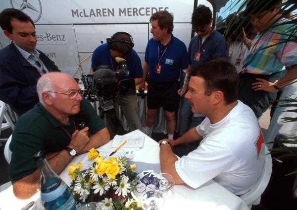 BBC TV Commentator Murray Walker (GBR) (left) talks with Nigel Mansell (GBR) (right) who finished tenth in his first race with McLaren. San Marino Grand Prix, Imola, Italy, 30 April 1995.