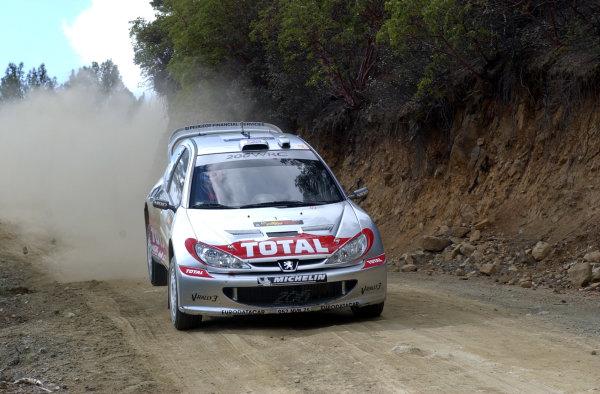 World Rally Championship, Cyprus Rally, April 18-21, 2002.Richard Burns lands after a jump on Stage 1, Leg 1.Photo: Ralph Hardwick/LAT