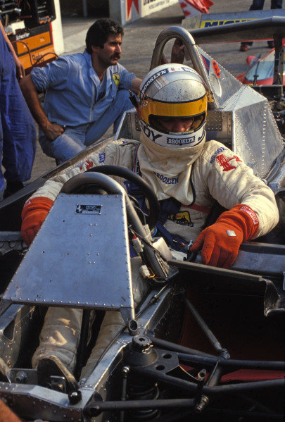 Jody Scheckter sits in the open cockpit of his Ferrari 312T4.