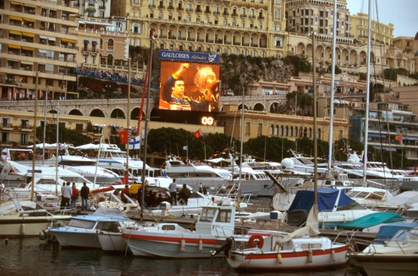 Monte Carlo, Monaco.16-19 May 1996.Olivier Panis (Ligier Mugen-Honda) 1st position celebrates victory as captured on the big screen by the harbour.Ref-96 MON 04.World Copyright - LAT Photographic