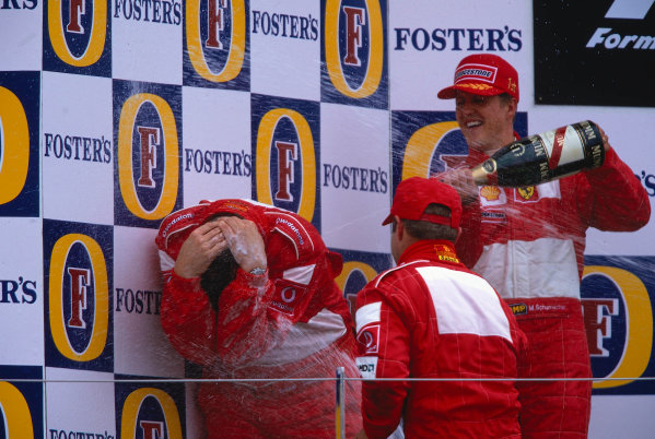 2002 British Grand Prix, Silverstone, England. 7th July 2002 Ross Brawn gets a champagne shower from his drivers after Ferrari took 1st and 2nd positions.World Copyright - LAT Photographic Ref: 35mm Original A47