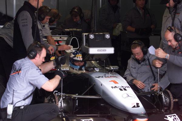 2000 European Grand Prix.Nurburgring, Germany.19-21 May 2000.Mika Hakkinen (McLaren Mercedes) in the garage during qualifying.World Copyright - LAT Photographic