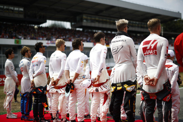 The drivers stand to attention for the national anthem. L-R: Kevin Magnussen, Haas F1 Team, Nico Hulkenberg, Renault Sport F1 Team, Charles Leclerc, Sauber, Fernando Alonso, McLaren, Marcus Ericsson, Sauber, Daniel Ricciardo, Red Bull Racing, Pierre Gasly, Toro Rosso, and Lance Stroll, Williams Racing.