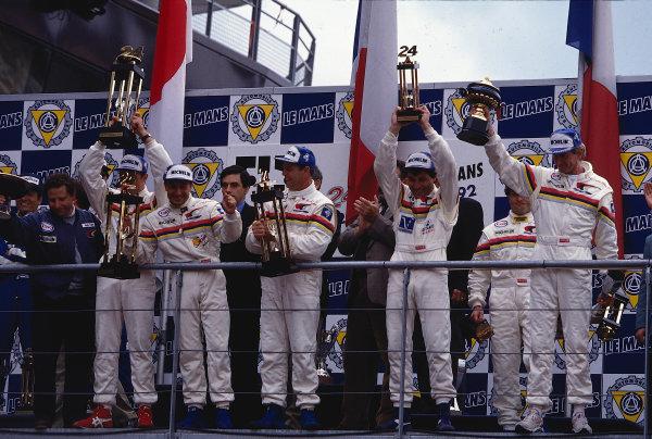 Le Mans 24 Hours, Le Mans, France. 20th-21st June 1992. Peugeot drivers celebrate on the podium with Ferrari Team Principal Jean Todt. World Copyright: LAT Photographic Ref: 92LM04
