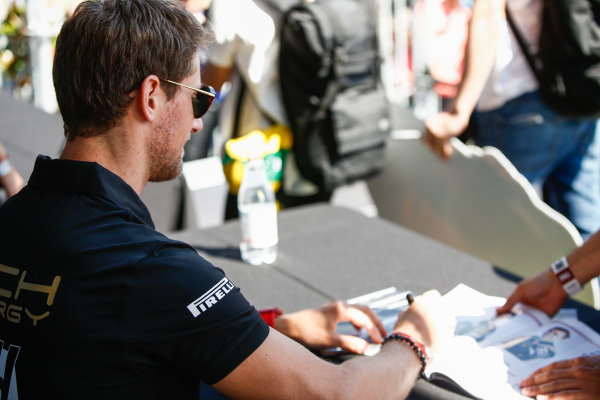Romain Grosjean, Haas F1, signs autographs for fans