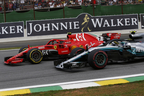 Kimi Raikkonen, Ferrari SF71H and Valtteri Bottas, Mercedes-AMG F1 W09 EQ Power+ battle