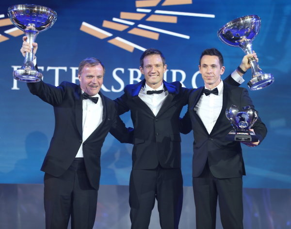 Sebastien Ogier and Julien Ingrassia on stage with their trophies