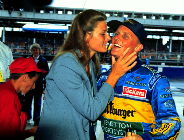 1995 British Grand Prix.Silverstone, England.14-16 July 1995.Johnny Herbert (Benetton Renault) celebrates with his wife Becky after winning his home GP.World Copyright - LAT Photographic