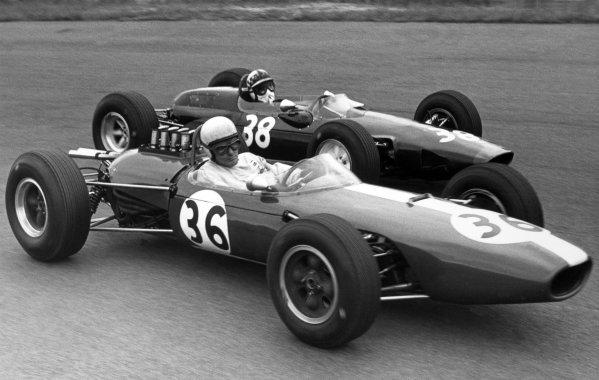1965 Dutch Grand Prix.Zandvoort, Holland. 18 July 1965.Bob Anderson, Brabham BT11-Climax, retired, leads Innes Ireland, Lotus 25-BRM, 10th position, action.World Copyright: LAT PhotographicRef: Motor b&w print