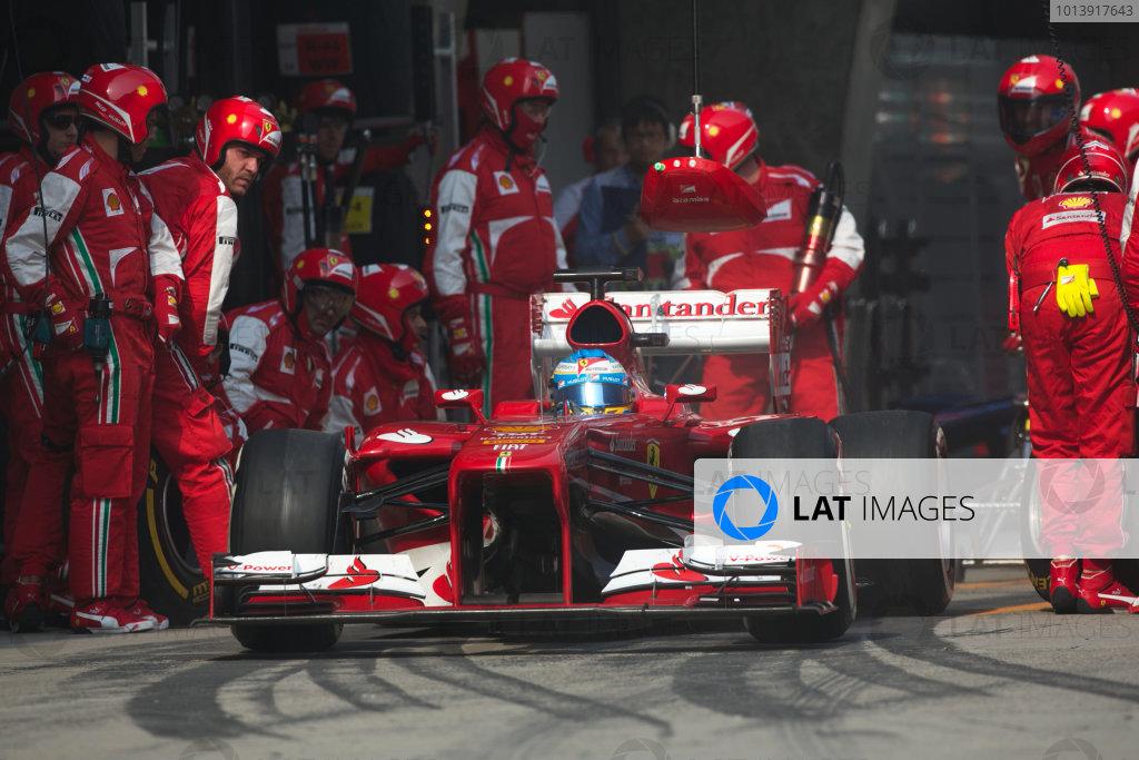 Shanghai International Circuit, Shanghai, China Sunday 14th April 2013 Fernando Alonso, Ferrari F138, leaves the pits. World Copyright: Andy Hone/LAT Photographic ref: Digital Image HONZ7024
