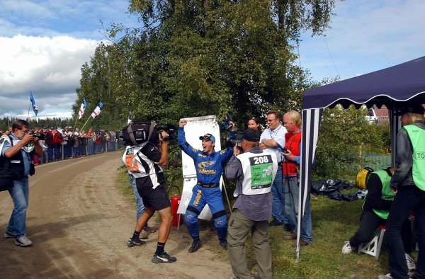 Petter Solberg (NOR), Subaru, is told that he has snatched second place from Richard Burns (GBR), Peugeot. He celebrated as though he had won the rally!