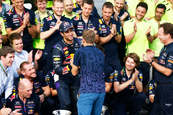 Hungaroring, Budapest, Hungary. Sunday 27 July 2014. Sebastian Vettel, Red Bull Racing, congratulates Daniel Ricciardo, Red Bull Racing, 1st Position, at the team celebration. World Copyright: Andy Hone/LAT Photographic. ref: Digital Image _ONY2882