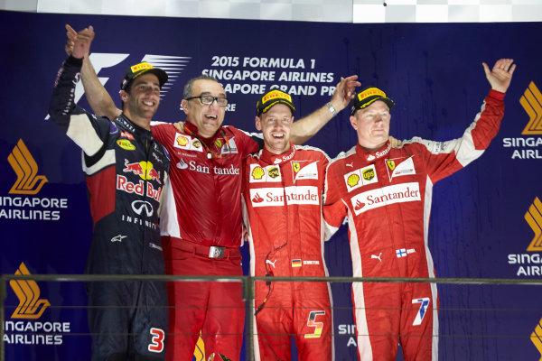 Marina Bay Circuit, Singapore. Sunday 20 September 2015. Daniel Ricciardo, Red Bull Racing, 2nd Position, Sebastian Vettel, Ferrari, 1st Position, and Kimi Raikkonen, Ferrari, 3rd Position. World Copyright: Steve Etherington/LAT Photographic ref: Digital Image SNE29672