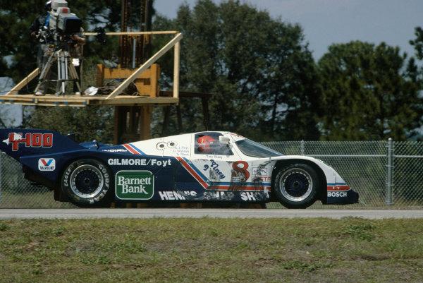 Sebring 12 Hours, Florida, USA.  22nd March 1986. Rd 3. Drake Olsen/A.J Foyt/Danny Sullivan/Preston Henn (Porsche 962), retired, action. World Copyright: Bill Murenbeeld/LAT Photographic. Ref:  86IMSA SEB02.