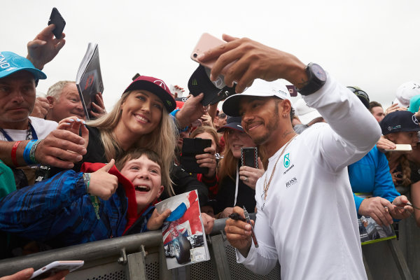 Silverstone, Northamptonshire, UK.  Saturday 15 July 2017. Lewis Hamilton, Mercedes AMG, takes a photo with fans. World Copyright: Steve Etherington/LAT Images  ref: Digital Image SNE18307