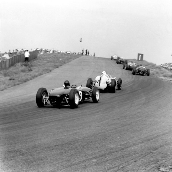 1960 Dutch Grand Prix. Zandvoort, Holland. 6th June 1960. Jim Clark (Lotus 18-Climax), retired, on his debut follows Tony Brooks (BRM T51-Climax), retired, action. World Copyright: LAT Photographic. Ref: 6530.