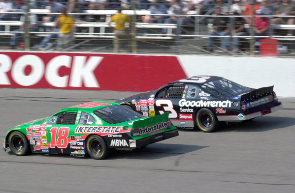 2000 NASCAR Winston Cup. North Carolina Speedway, Rockingham, NC, USA. 20th - 22nd October 2000. Rd 31. Dale Earnhardt (GM Goodwrench Service Chevrolet), 17th position, leads Bobby Labonte (Interstate Batteries Pontiac), 20th position, action.  World Copyright: Robt LeSieur / LAT Photographic.