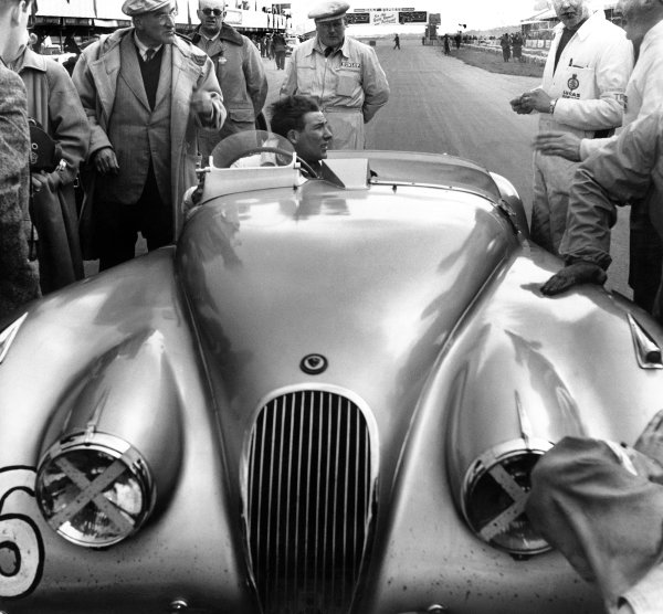 Silverstone, England. 5th May 1951. Stirling Moss (Jaguar XK120), 1st position in the Production Sports Car race, portrait. World Copyright: LAT Photographic. Ref: Autocar Used Pic 11th May 1951 Pg 538.