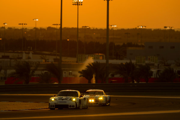 2015 FIA World Endurance Championship Bahrain 6-Hours Bahrain International Circuit, Bahrain Saturday 21 November 2015. Richard Lietz, Michael Christensen (#91 GTE PRO Porsche AG Team Manthey Porsche 911 RSR) leads Francesco Castellacci, Roald Goethe, Stuart Hall (#96 GTE AM Aston Martin Racing Aston Martin Vantage V8). World Copyright: Sam Bloxham/LAT Photographic ref: Digital Image _G7C1747