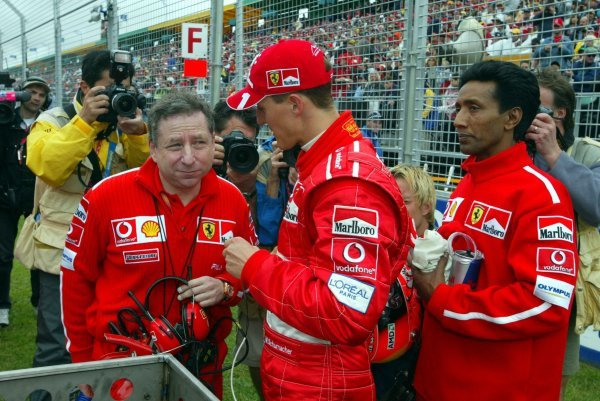 (L to R): Jean Todt (FRA) Ferrari General Manager talks with Michael Schumacher (GER) Ferrari as Schumacher's personal trainer Balbir Singh (IND) holds onto the drinks on the grid.