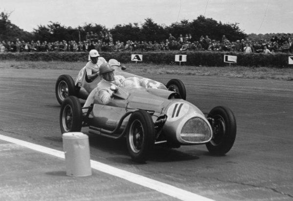 1952 British Grand Prix.Silverstone, Great Britain. 19 July 1952.Alan Brown (Cooper T20-Bristol) leads Harry Schell (Maserati 4CLT/48-Plate). Ref-C33015.World Copyright - LAT Photographic